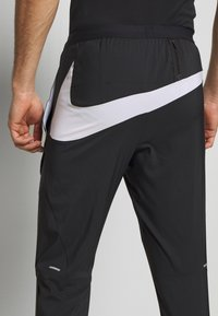 Nike Performance - WILD RUN - Verryttelyhousut - black/white - 4