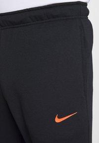 Nike Performance - DRY PANT - Verryttelyhousut - black/hyper crimson - 4