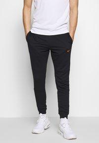 Nike Performance - DRY PANT - Verryttelyhousut - black/hyper crimson - 0