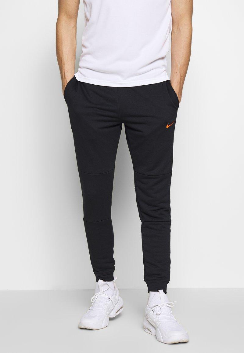 Nike Performance - DRY PANT - Verryttelyhousut - black/hyper crimson