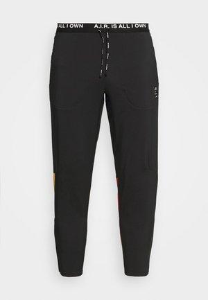 PANT ART - Tracksuit bottoms - black