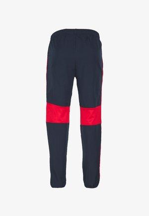 ACADEMY  - Pantalon de survêtement - obsidian/university red/white