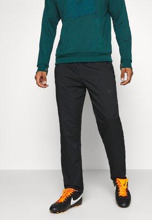 DRY PANT TEAM WOVEN - Spodnie treningowe - black