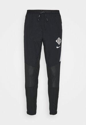 ELITE PANT - Verryttelyhousut - black/reflective silver