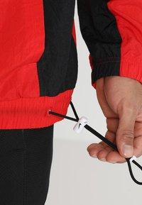 Nike Performance - RETRO - Windjack - university red/black/white - 6