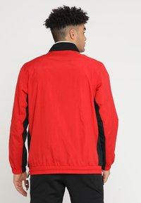 Nike Performance - RETRO - Windjack - university red/black/white - 2