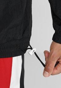 Nike Performance - RETRO - Windbreaker - black/white - 5