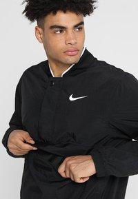 Nike Performance - RETRO - Windbreaker - black/white - 4