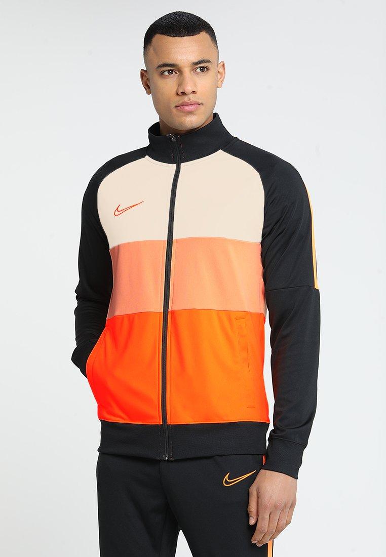 Nike Performance - DRY ACADEMY - Training jacket - black/guava ice/total orange