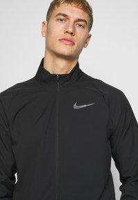 Nike Performance - DRY TEAM - Training jacket - black/black - 3