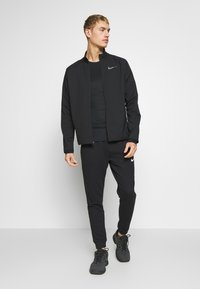 Nike Performance - DRY TEAM - Training jacket - black/black - 1