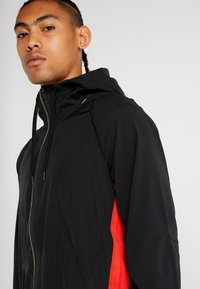 Nike Performance - FLEX - Giacca sportiva - black/electric green - 3