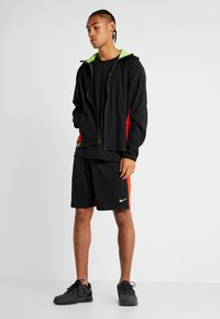 Nike Performance - FLEX - Giacca sportiva - black/electric green - 1