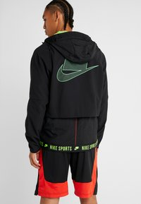 Nike Performance - FLEX - Giacca sportiva - black/electric green - 2