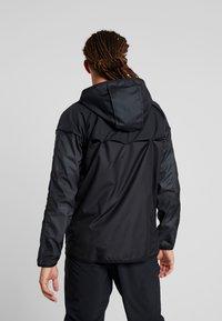 Nike Performance - WILD RUN - Sports jacket - off noir/black/reflective silver - 2