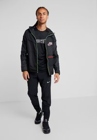 Nike Performance - WILD RUN - Sports jacket - off noir/black/reflective silver - 1