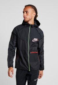 Nike Performance - WILD RUN - Sports jacket - off noir/black/reflective silver - 0