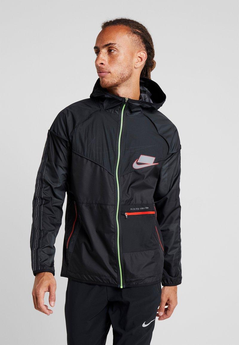 Nike Performance - WILD RUN - Sports jacket - off noir/black/reflective silver