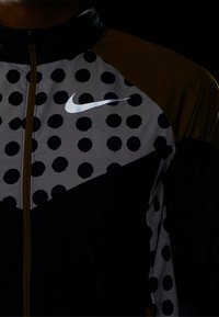 Nike Performance - WINDRUNNER ARTIST - Sports jacket - obsidian/beechtree/reflective silver