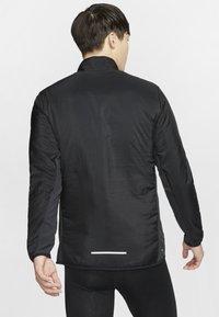 Nike Performance - AROLYR - Träningsjacka - black/grey - 2