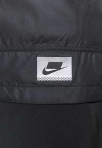 Nike Performance - WILD RUN SHIELD - Sports jacket - black/off noir/reflective silver - 9