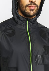 Nike Performance - WILD RUN SHIELD - Sports jacket - black/off noir/reflective silver - 5