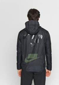 Nike Performance - WILD RUN SHIELD - Sports jacket - black/off noir/reflective silver - 2