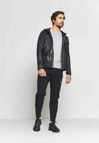 Nike Performance - WILD RUN SHIELD - Sports jacket - black/off noir/reflective silver - 1