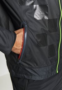 Nike Performance - WILD RUN SHIELD - Sports jacket - black/off noir/reflective silver - 6