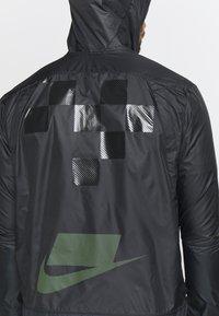 Nike Performance - WILD RUN SHIELD - Sports jacket - black/off noir/reflective silver - 4