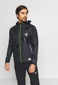 Nike Performance - WILD RUN SHIELD - Sports jacket - black/off noir/reflective silver - 0