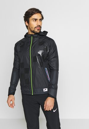 WILD RUN SHIELD - Veste de running - black/off noir/reflective silver