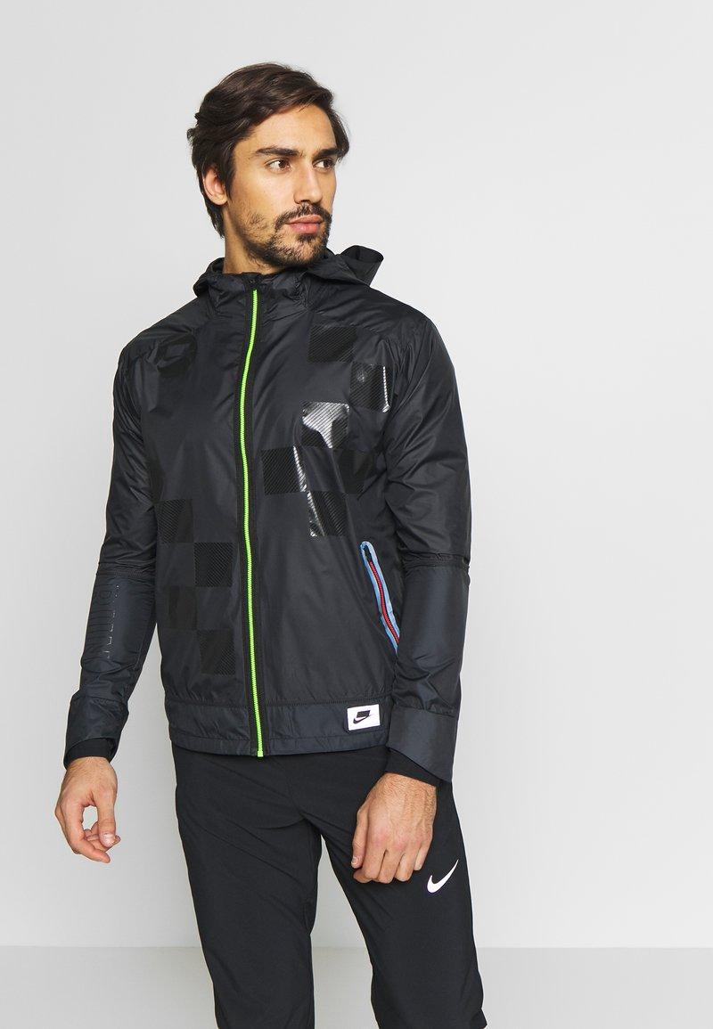 Nike Performance - WILD RUN SHIELD - Sports jacket - black/off noir/reflective silver