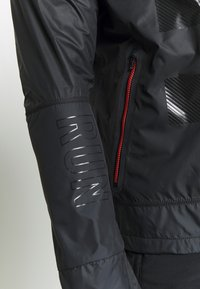 Nike Performance - WILD RUN SHIELD - Sports jacket - black/off noir/reflective silver - 7