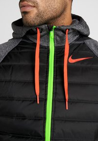 Nike Performance - Outdoor jacket - black heather/black/habanero red - 5