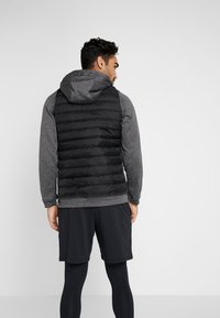 Nike Performance - Outdoor jacket - black heather/black/habanero red
