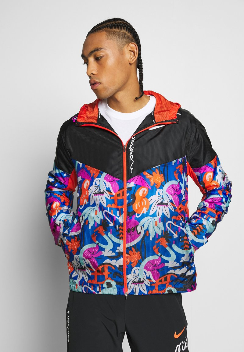 Nike Performance - WINDRUNNER - Sports jacket - black/team orange