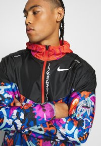 Nike Performance - WINDRUNNER - Sports jacket - black/team orange - 3