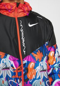 Nike Performance - WINDRUNNER - Sports jacket - black/team orange - 6