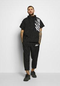 Nike Performance - Training jacket - black - 1