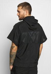 Nike Performance - Training jacket - black - 2