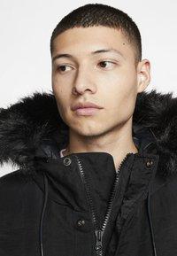 Nike Performance - SPORTSWEAR DOWN-FILL HOODIE - Down coat - black - 2