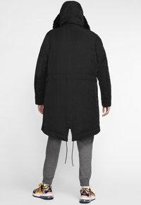 Nike Performance - SPORTSWEAR DOWN-FILL HOODIE - Down coat - black - 1