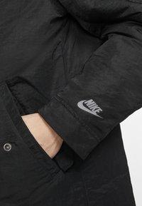 Nike Performance - SPORTSWEAR DOWN-FILL HOODIE - Down coat - black - 7