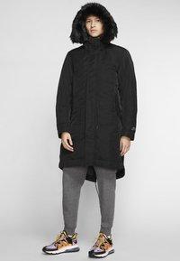 Nike Performance - SPORTSWEAR DOWN-FILL HOODIE - Down coat - black - 0