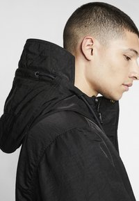 Nike Performance - SPORTSWEAR DOWN-FILL HOODIE - Down coat - black - 4