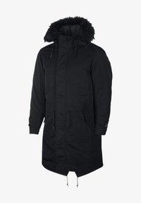 Nike Performance - SPORTSWEAR DOWN-FILL HOODIE - Down coat - black - 8