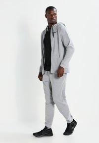 Nike Performance - Zip-up hoodie - dark grey heather/black - 1