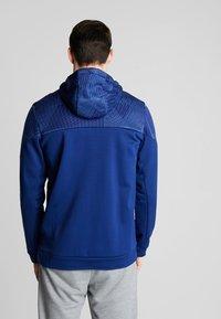 Nike Performance - THERMA - Felpa con cappuccio - blue void/black - 2