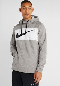 Nike Performance - THERMA - Jersey con capucha - dark grey heather/black - 0